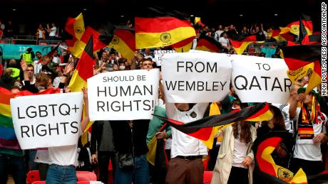 Germany fans hold up signs in relation to LGBTQ+ rights during the UEFA Euro 2020 round of 16 match at Wembley Stadium, London
