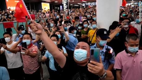 Supporters of Huawei CFO Meng Wanzhou gather at Shenzhen Bao'an International Airport in southern China to welcome her return.