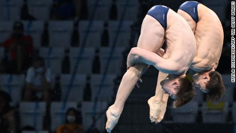 Li (left) and Daly compete in the men's double 10-meter platform final.