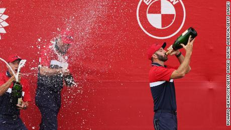 Johnson celebrates with champagne after defeating Team Europe at the 43rd Ryder Cup.
