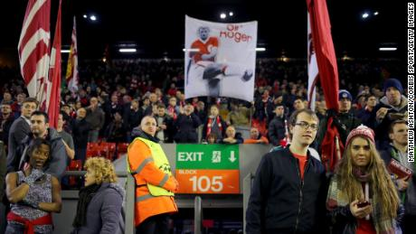 Liverpool fans on The Kop at Anfield with a banner of Sir Roger Hunt on Dec. 9, 2014.