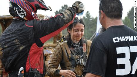 Mia Chapman's face is rinsed off after the race.