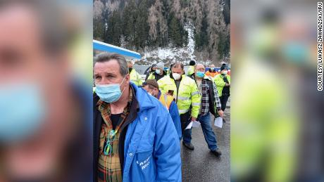 Truck drivers line up to show testing documentation on the Brenner Pass on February 16.
