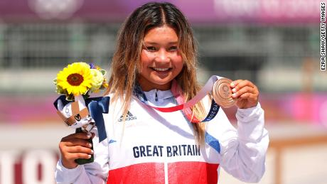 Brown poses with her Olympic bronze at Ariake Urban Sports Park.