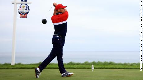 DeChambeau drives from the 16th tee during Sunday's Singles matches.