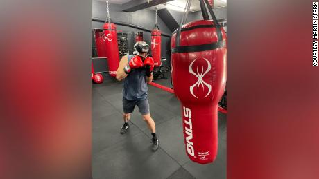 Stark training with a punching bag.