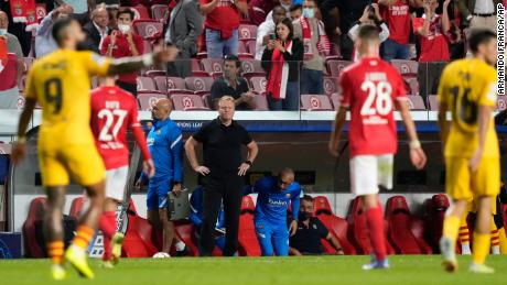 Koeman watches as players leave the field at half time.