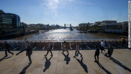 Commuters walk across London Bridge on May 27.