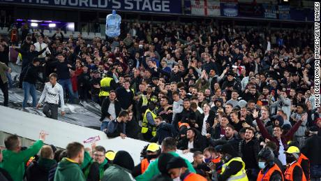 A water cooler is thrown amongst fans in the stands during the UEFA Europa League Group H match at the London Stadium, London.