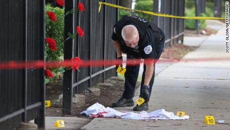 Police investigate a crime scene where three people were shot -- one fatally -- in the Bridgeport neighborhood on June 23, 2021, in Chicago.