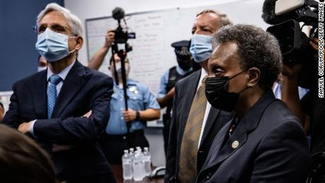 US Attorney General Merrick Garland (left), with Sen. Dick Durbin and Chicago Mayor Lori Lightfoot, visited Chicago in July. Chicago is among the five cities at the center of the Department of Justice's newest anti-gun trafficking strike forces.