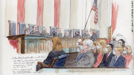 Deputy Attorney General Lisa Monaco moves to have Justice Amy Coney Barrett's commission read by the Clerk at the Supreme Court, Friday, October 1.