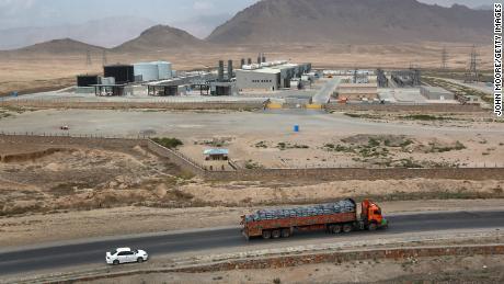 Traffic passes by the Tarakhil power plant in September 2011.