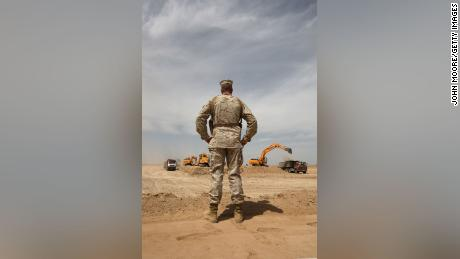 US Marine MSgt. Charles Albrecht watches a construction crew working on a massive new base at Camp Letherneck, Helmand province, in March 2009.