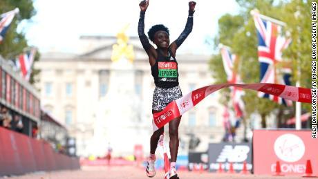 Jepkosgei celebrates as she crosses the line in London.