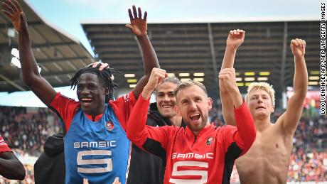Rennes' players celebrate a famous win against PSG.