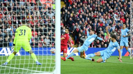 Mohamed Salah scores his sides second goal during the Premier League match against Manchester City.