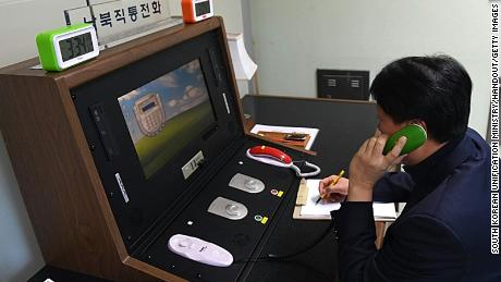 A South Korean government official communicates with a North Korean officer on the dedicated communications hotline at the border village of Panmunjom, South Korea, on January 3, 2018.