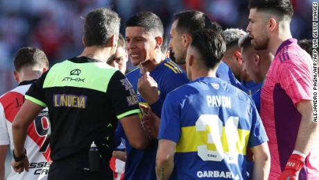 Marcos Rojo argues with the referee after being sent off.