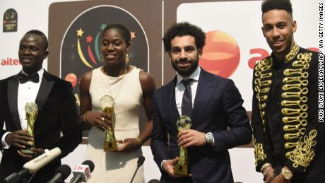Footballing royalty: The Nigerian picked up her third African Female Footballer of the Year at the 2017 CAF Awards with Liverpool and Egypt's Mohamed Salah (R) picking up the Men's Award