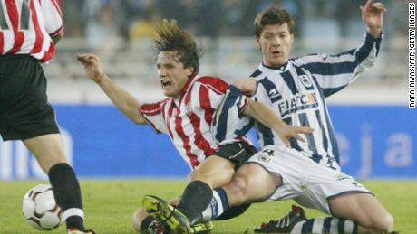Alonso began his playing career with Real Sociedad. Here Alonso (R) vies with Athletic Bilbao's Carlos Gurpegui (L) during a 2004 derby.
