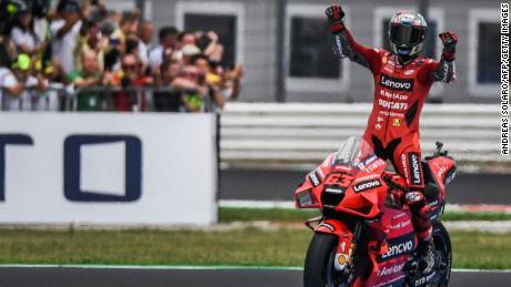 Bagnaia celebrates after winnign the San Marino MotoGP Grand Prix.