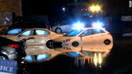 Water surrounds vehicles in a parking lot in Birmingham on Thursday morning.