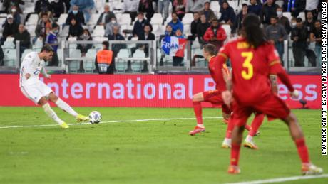 Theo Hernandez scores the winner against Belgium in Turin, Italy.