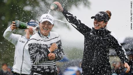Gabby Lopez (right) and Brooke Henderson (left) pour champagne on Ko after her win at the Founders Cup at Mountain Ridge Country Club.
