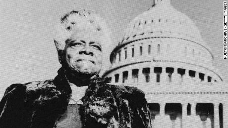 Mary McLeod Bethune stands with the U.S. Capitol in the background, circa 1950.