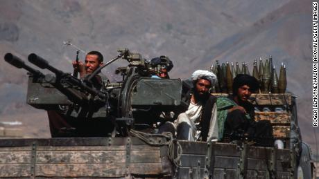 Taliban militiamen drive a heavily armed vehicle in Kabul, Afghanistan, on October 10, 1996.