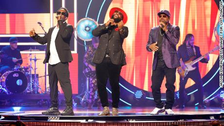 Shawn Stockman, Wanya Morris and Nathan Morris of Boyz II Men performing during the  CMT Artists of the Year event.