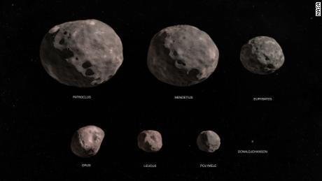 NASA's Lucy mission will explore seven Trojan asteroids. This illustration shows the binary asteroid Patroclus/Menoetius, Eurybates, Orus, Leucus, Polymele and the main belt asteroid DonaldJohanson.