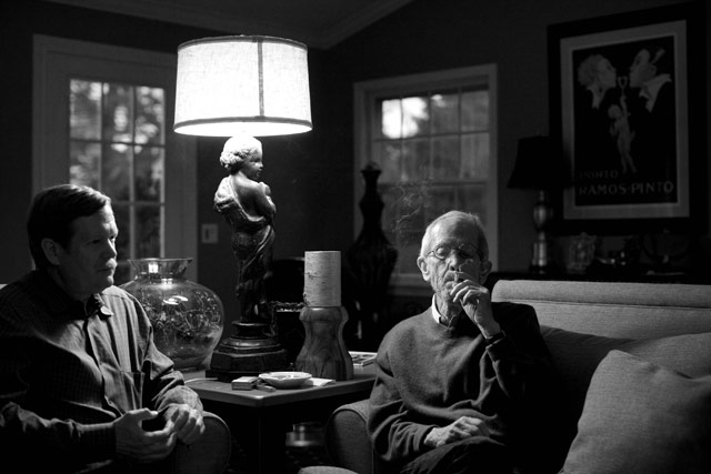 Peter Leonard listens in his family room while his father, Elmore, smokes and talks about writing.