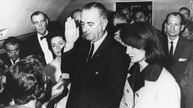 Sarah Hughes, lower left, became the only woman to preside over a presidential oath when she swore in Lyndon Johnson.