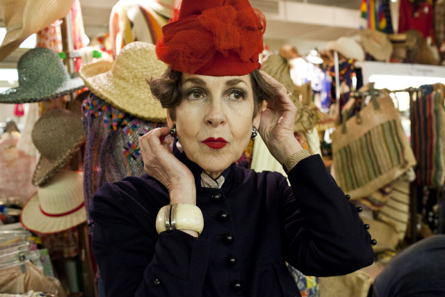 Tziporah Salamon, 62, tries on a hat at the Manhattan Vintage Clothing Show.