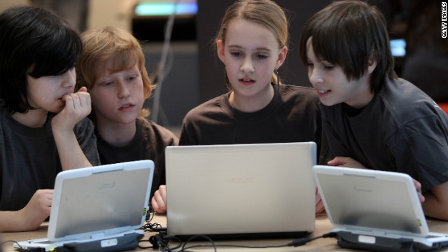 Kids tried out laptops at a tech fair in Germany this year, but a futurist predicts more screens in classrooms.