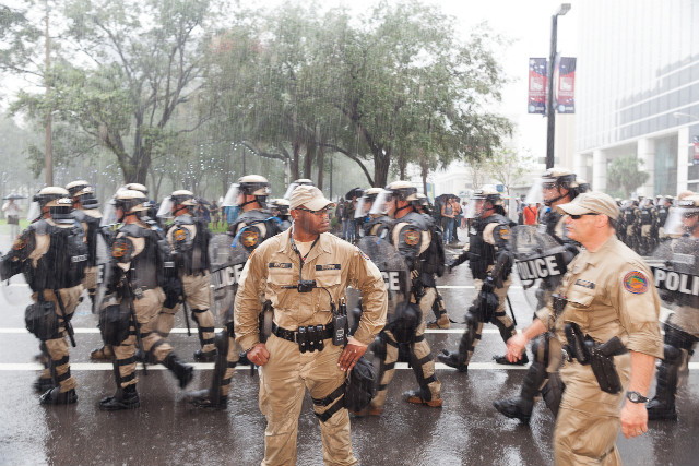 Police march by during the Republican convention on Thursday, August 30. - (Zoran Milich for CNN)