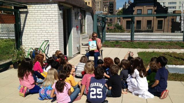 Parent Vicki Sando reads to a group of students on the P.S. 41 Green Roof.