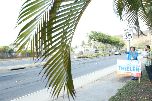 Hawaii bans billboards; so candidates stand by the road and wave to commuters.