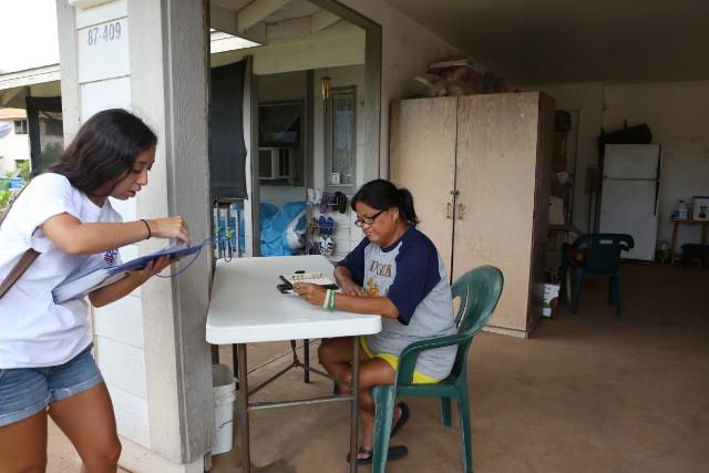 Kanu volunteers convinced this woman, Marlene Joshua, to vote in November.