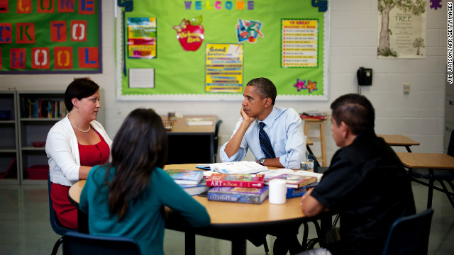 President Barack Obama talks with teachers during a education roundtable at Canyon Springs High School in Las Vegas, Nevada on August 22, 2012.