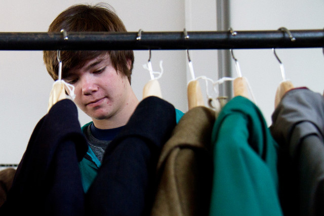 Nick Rokosz, 16, looks through vintage coats from MidNorth Mercantile.