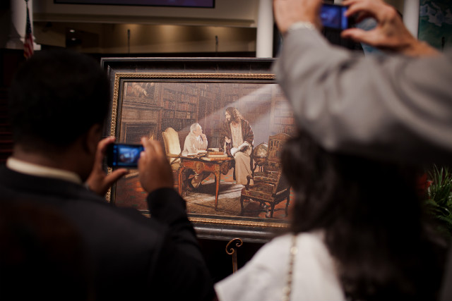 Churchgoers crowd around a picture of the Rev. Charles Stanley given to him at a service.
