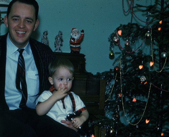 Andy, then about 4, with his father, the Rev. Charles Stanley, during Christmas. - (Courtesy of Charles Stanley)