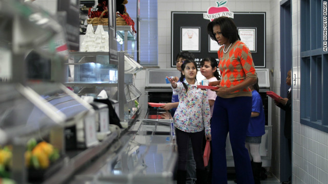 U.S. first lady Michelle Obama joins students in the lunch line at an Alexandria, Virginia, school.