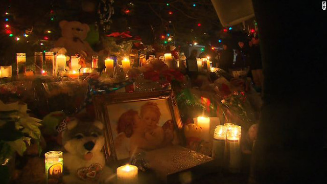 A makeshift memorial pays tribute to the victims of Friday's shooting at Sandy Hook Elementary School in Newtown, Connecticut.