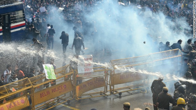 Police unleash water cannon and fire tear gas towards in Delhi on December 22, 2012.