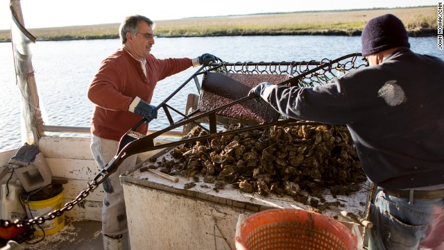 George Barisich, left, and his deckhand Bob Caretto separate oysters dredged from Bayou Yscloskey, Louisiana.