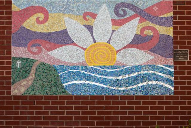 A mosaic in memory of Lauren Astley hangs at her alma mater, Wayland High School.